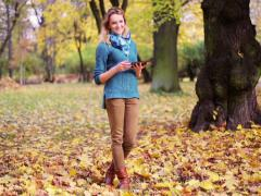 Pretty girl using tablet and smiling to the camera in the park Stock Footage