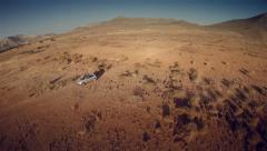 Lateral aerial view of a 4 by 4 car through the desert. Spain. 4k Stock Footage