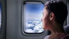 Female traveling on an airplane - stock footage