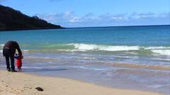 Man & Child On Sandy Beach Slow-motion Coast Blue Sea Ocean Water - stock footage
