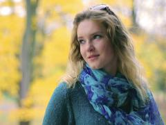 Happy girl standing alone in the park in autumn Stock Footage