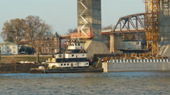4K Towboat Pulls Barge at Construction Site  1 Stock Footage