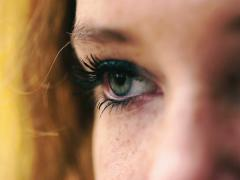 Absorbed woman looking on something, closeup Stock Footage