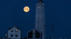 Detailed full moon setting behind Grotta light house, Reykjavik, Iceland 4k Stock Footage