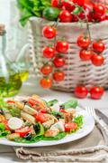 healthy salad with vegetables, pasta and croutons - stock photo