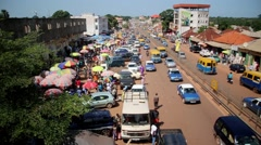 Africa Bandim traffic alongside street market Guinea Bisseau Stock Footage