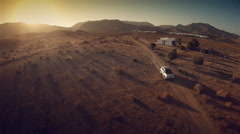 Aerial view of a 4 by 4 car in desert at sunset. Spain. 4k Stock Footage