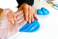 hand physiotherapy to recover a broken finger - stock photo