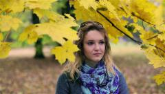 Pensive girl standing in the park - stock footage