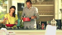Young couple cooking spaghetti in kitchen at home HD Stock Footage
