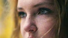 View of beautiful girl with blue eyes and freckles, closeup Stock Footage