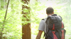 Hiking man stops to take a picture Stock Footage
