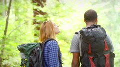 Man and woman hiking turn around and take a picture - stock footage