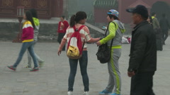 Chinese tourists take pictures Stock Footage