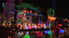 House with thousands of Christmas lights covering it - stock footage