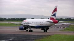 British Airways Airbus A319 taxiing at Manchester Airport - stock footage