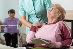 Therapist in nursing home Stock Photos