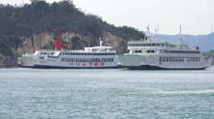 Two Ferry Boats Pass Each Other The Island Of Naoshima Japan 4K Stock Footage