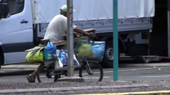 A man pushing a bike Stock Footage