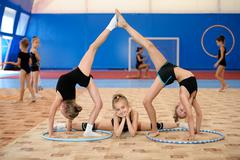 Gymnastic composition made by three girls Stock Photos