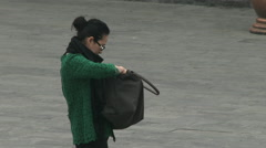 Chinese woman searches purse Stock Footage
