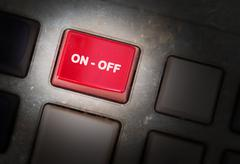 red button on a dirty old panel - stock photo