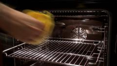 Inserting meatloaf on a baking sheet to the oven. Stock Footage