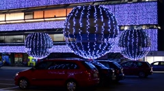 Building christmas lights with parked cars - night Stock Footage
