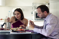 Young couple eating breakfast at home NTSC Stock Footage