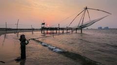 Chinese fishnets on sunset. Fort Kochin, Kochi, Kerala, India Stock Footage