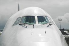 Detail of aircraft nose with cockpit window Stock Photos