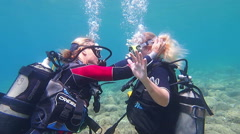 Learning to scuba dive - stock footage
