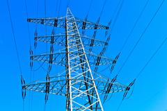 Steel electricity pylon on bright blue sky Stock Photos