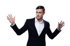 Happy businessman standing with hands on the sides Stock Photos