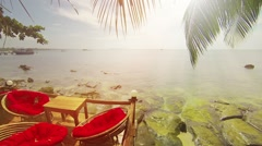 Comfortable seating for a tropical beach view Stock Footage