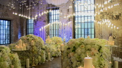 Ceremonial hall richly decorated with flowers Stock Footage
