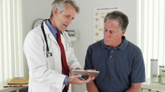 Doctor and patient talking in the office Stock Footage