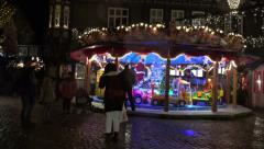 4k Carousel at Christmas market with happy people panning Stock Footage