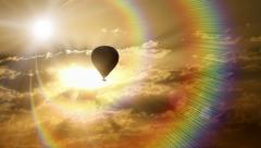 Hot air balloon in colorful sunset rays. - stock footage