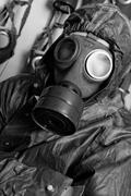 Photo of a man in wwii's clothes and gas mask Stock Photos
