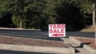 Stock Video Footage of yard sale sign pointing left