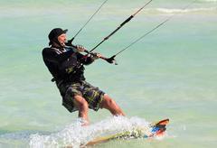 Man riding his kiteboard. Cayo Guillermo in Atlantic Ocean. - stock photo
