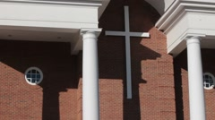White cross hanging on front of church Stock Footage