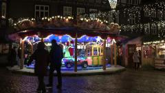 4k Christmas market stores panning with carousel and candy shop Stock Footage