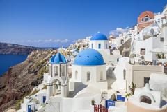 Greek church with three blue domes in the village of Oia, Santorini (Thira), Stock Photos