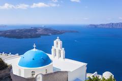 Blue dome and bell tower above Aegean Sea, St. Gerasimos church, Firostefani, - stock photo