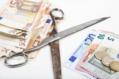 monetary scissors come apart - stock photo