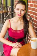 Beautiful young latvian woman at cafe with latte on table Stock Photos