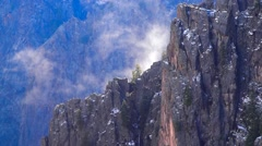 Clouds Slowly Rise Over Canyon Wall Stock Footage