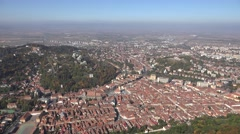 ULTRA HD 4K Aerial view Brasov medieval city Romanian cityscape red rooftop sky Stock Footage